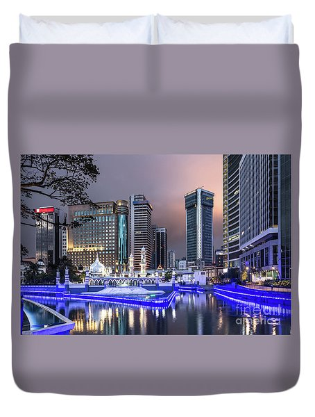 The Office Buildings Reflects In The Water Of The Klang River In Duvet Cover