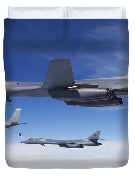 A B-1b Lancer Stands By As Another Duvet Cover by Stocktrek Images
