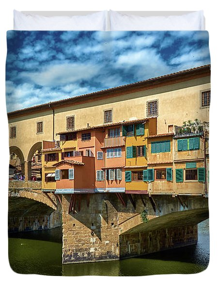 Ponte Vecchio On The Arno River Under A Blue Sky In Florence, Italy Duvet Cover