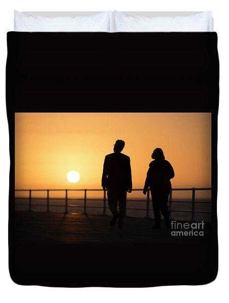 A Couple In Silhouette Walking Into The Sunset Duvet Cover