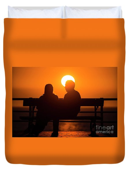 A Couple Sitting At Sunset Duvet Cover