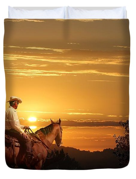 A Cowboy Riding On His Horse Into A Yellow Sunset. Duvet Cover