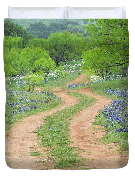 A Dirt Road Lined By Blue Bonnets Of Texas Duvet Cover