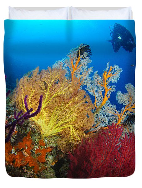 A Diver Looks On At A Colorful Reef Duvet Cover