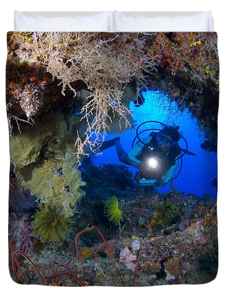 A Diver Peers Through A Coral Encrusted Duvet Cover by Steve Jones