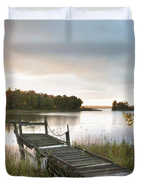 A Dock On A Lake At Sunrise Near Wawa Duvet Cover by Susan Dykstra