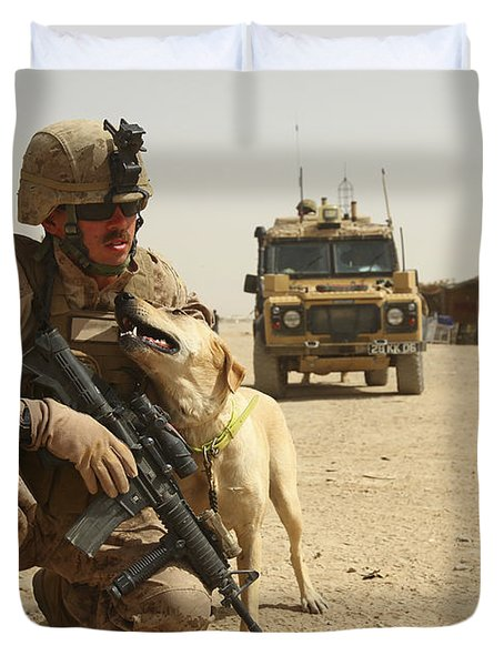 A Dog Handler Posts Security With An Duvet Cover by Stocktrek Images