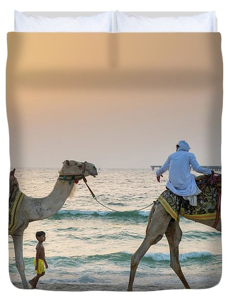 A Little Boy Stares In Amazement At A Camel Riding On Marina Beach In Dubai, United Arab Emirates Duvet Cover