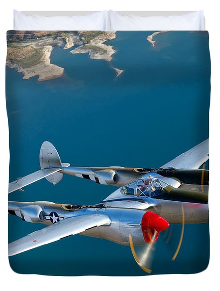 Duvet Cover featuring the photograph A Lockheed P-38 Lightning Fighter by Scott Germain