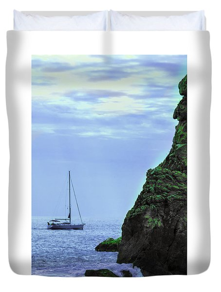 A Lone Sailboat Floats On A Calm Sea Duvet Cover