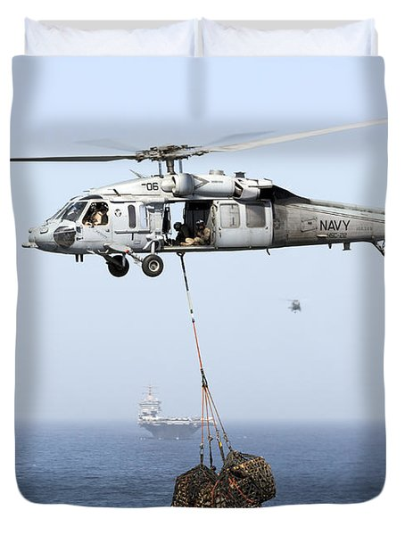 A Mh-60 Helicopter Transfers Cargo Duvet Cover by Gert Kromhout