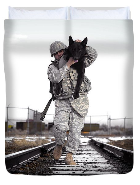 A Military Dog Handler Uses An Duvet Cover by Stocktrek Images