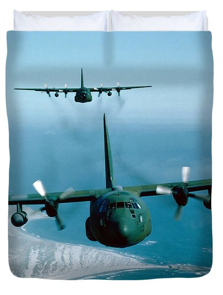 Duvet Cover featuring the photograph A Pair Of C-130 Hercules In Flight by Stocktrek Images