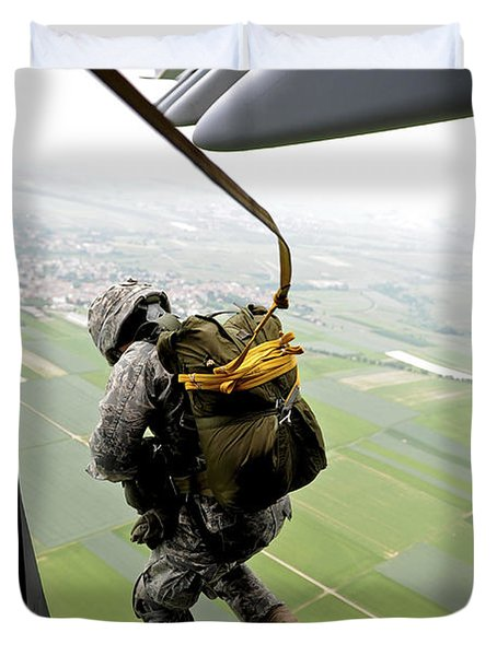 Duvet Cover featuring the photograph A Paratrooper Executes An Airborne Jump by Stocktrek Images
