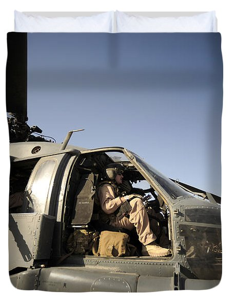 A Pilot Sits In The Cockpit Of A Hh-60g Duvet Cover by Stocktrek Images