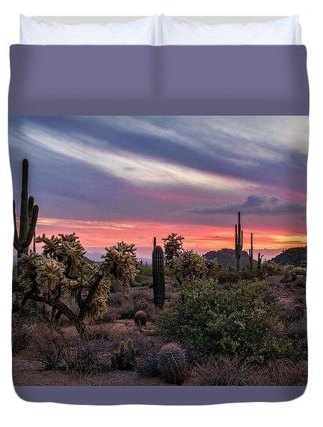 Duvet Cover featuring the photograph A Pink Kissed Desert Sunset  by Saija Lehtonen