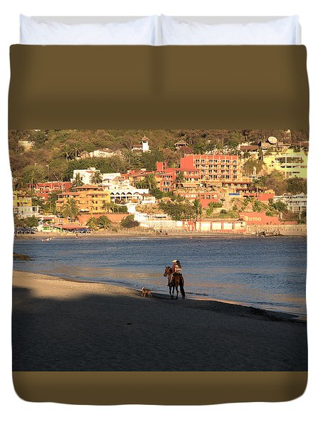 Duvet Cover featuring the photograph A Ride On The Beach by Jim Walls PhotoArtist