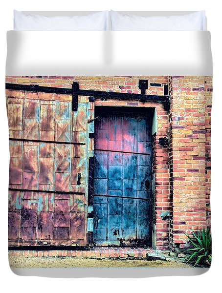 A Rusty Loading Dock Door Duvet Cover by Diana Mary Sharpton