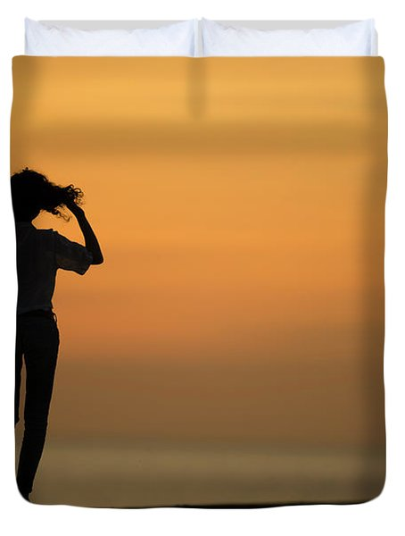 A Slim Woman Walking At Sunset Duvet Cover