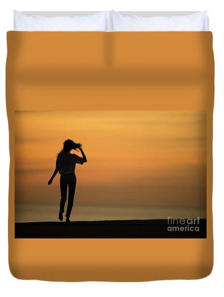 A Slim Woman Walking At Sunset Duvet Cover