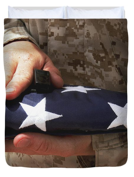A Soldier Holds The United States Flag Duvet Cover by Stocktrek Images