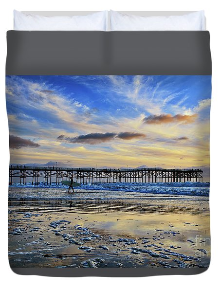 A Surfer Heads Home Under A Cloudy Sunset At Crystal Pier Duvet Cover