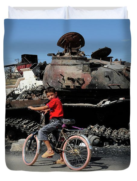 A Syrian Boy On His Bicycle In Front Duvet Cover by Andrew Chittock