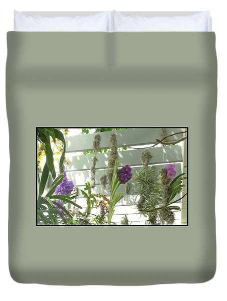 Duvet Cover featuring the photograph A Trio Of Orchids by Margie Avellino