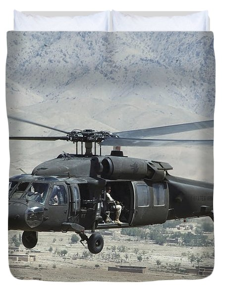 Duvet Cover featuring the photograph A Uh-60 Blackhawk Helicopter by Stocktrek Images