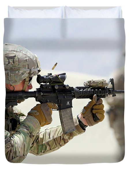 A U.s. Army Soldier, Fires An M4 Carbine Rifle Duvet Cover