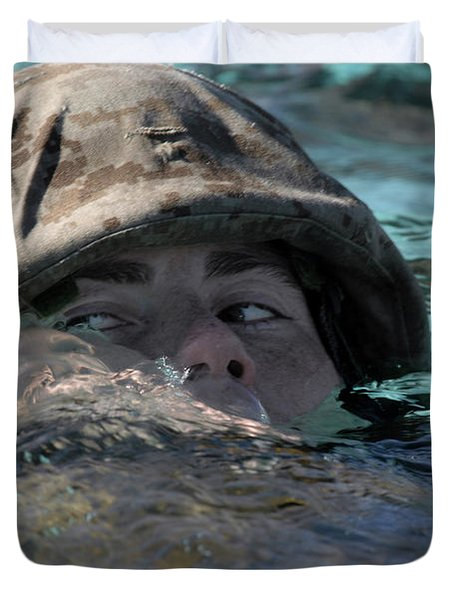 A U.s. Marine Swims Across A Training Duvet Cover by Stocktrek Images