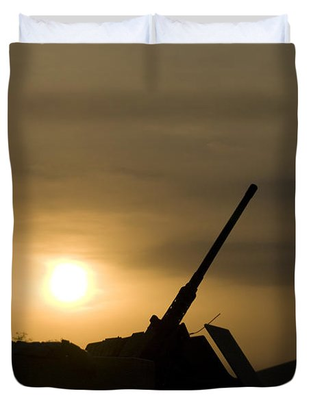 A Us Soldier Mans His .50 Caliber While Duvet Cover by Terry Moore