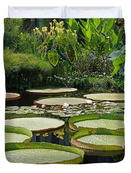 Duvet Cover featuring the photograph A Water Garden by Byron Varvarigos