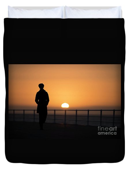 A Woman Silhouetted At Sunset Duvet Cover