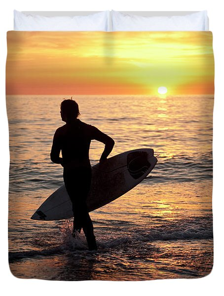 A Young Man Surfing At Sunset Off Aberystwyth Beach, Wales Uk Duvet Cover