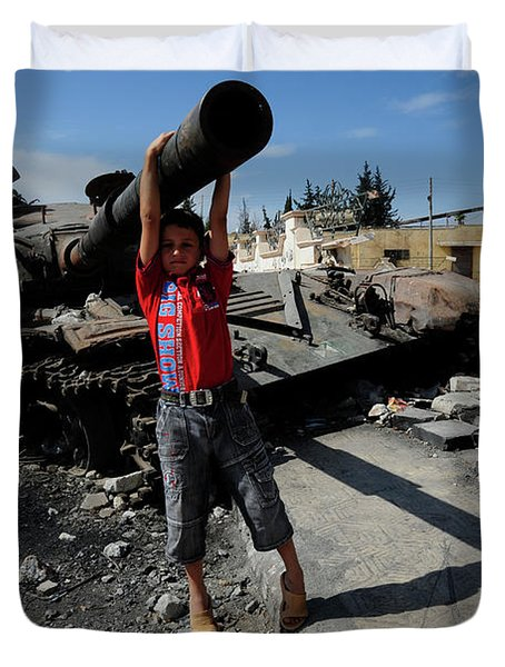 A Young Syrian Boy Plays On The Turret Duvet Cover by Andrew Chittock