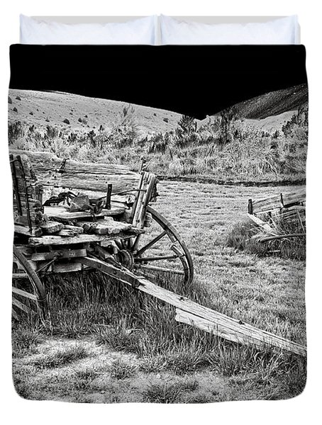 Abandoned Wagons Of Bannack Montana Ghost Town Duvet Cover by Daniel Hagerman
