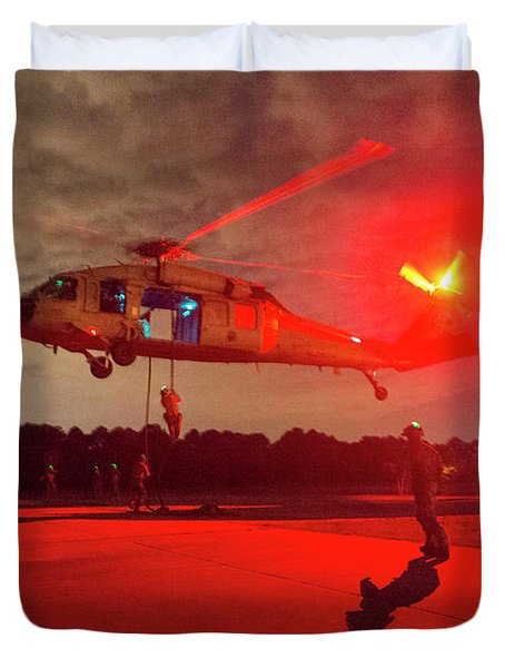 ailors fast rope from an MH-60S Sea Hawk helicopter during training Duvet Cover