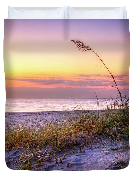 Duvet Cover featuring the photograph Alone At Dawn by Debra and Dave Vanderlaan