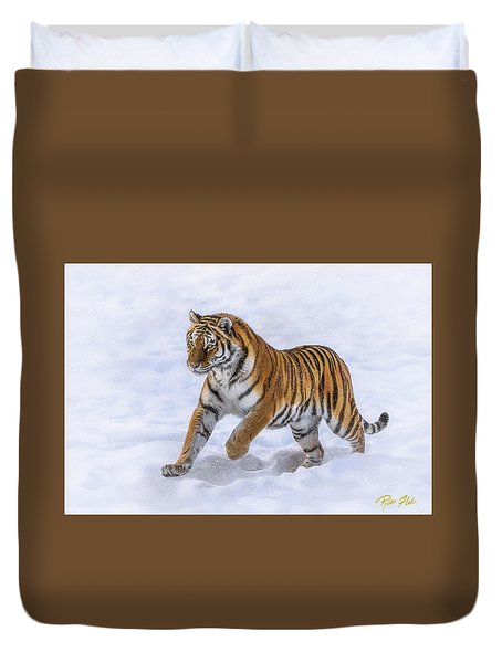 Duvet Cover featuring the photograph Amur Tiger Running In Snow by Rikk Flohr