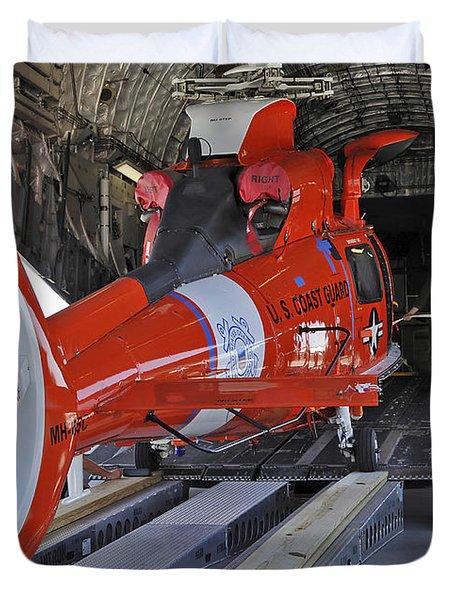 An Aircrew Loads A Coast Guard Hh-65 Duvet Cover by Stocktrek Images