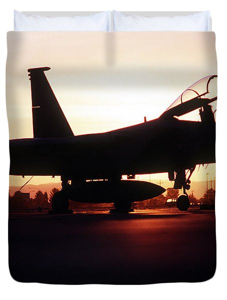 An F-15c Eagle Aircraft Silhouetted Duvet Cover by Stocktrek Images