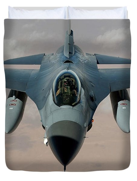 An F-16 Fighting Falcon Flies A Mission Duvet Cover by Stocktrek Images