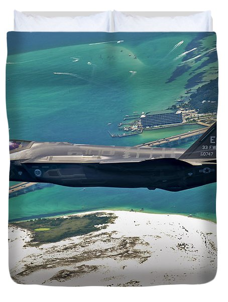 Duvet Cover featuring the photograph An F-35 Lightning II Flies Over Destin by Stocktrek Images
