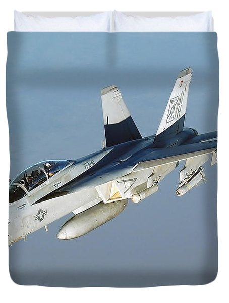 An Fa-18f Super Hornet Conducts Duvet Cover by Stocktrek Images