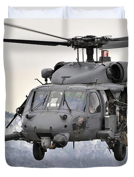 An Hh-60 Pave Hawk Helicopter In Flight Duvet Cover by Stocktrek Images
