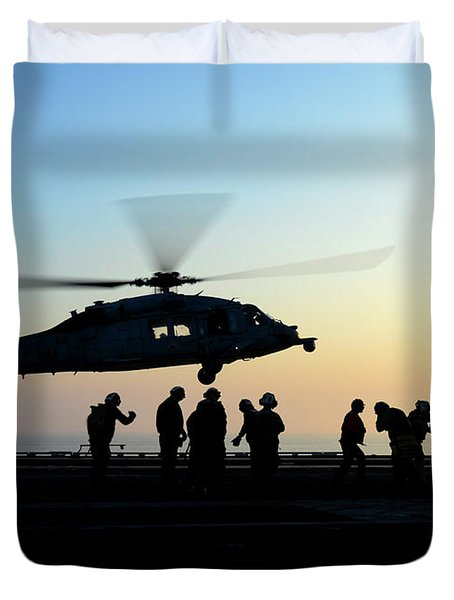 An Mh-60s Sea Hawk Helicopter Prepares To Land Aboard Uss Nimitz In The Arabian Gulf.   Duvet Cover