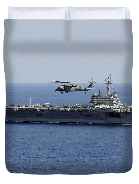 An Mh-60s Seahawk Helicopter Flies Duvet Cover by Stocktrek Images
