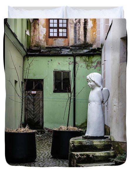 Angel In Courtyard Duvet Cover