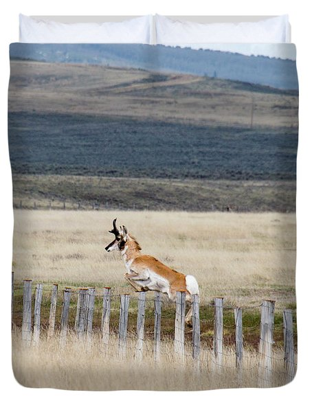 Duvet Cover featuring the photograph Antelope Jumping Fence 1 by Rebecca Margraf